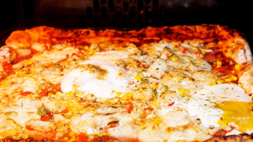Italy is going for a new world pizza record.