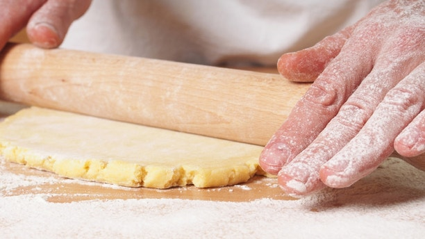 Roll out pastry to round. Making Apple Pie Tart Series.