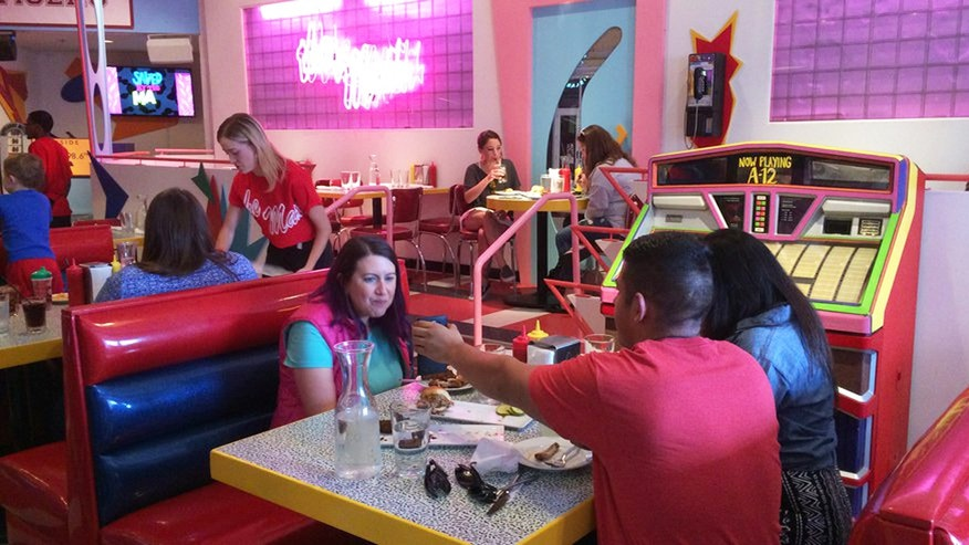 "Customers eat at pop-up restaurant Saved by the Max in Chicago. The space is inspired by The Max, the fictitious hangout from the TV sitcom ""Saved by the Bell."""