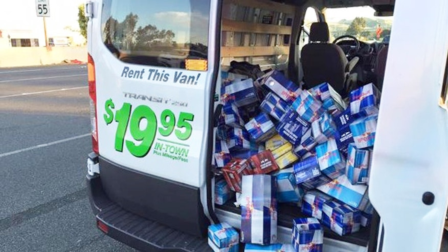 A police photo displays cases of stolen Red Bull spilling out of a U-Haul van.