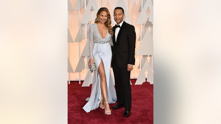 Model-turned-cookbook author Chrissy Teigen poses with husband, musician John Legend.