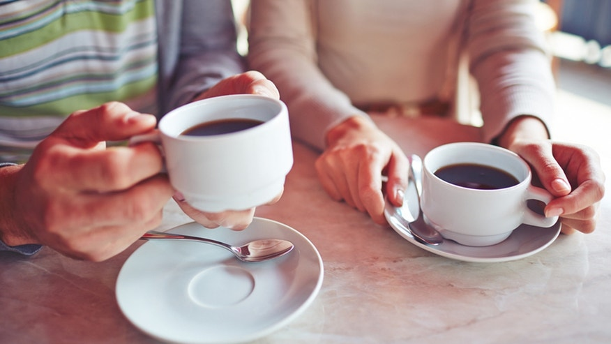 Close-up of couple drinking coffee