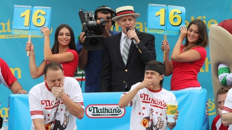 Joey Chestnut, left, and Matt Stonie face off in Nathan's Famous Fourth of July International Hot Dog Eating Contest men's competition, July 4, 2015.
