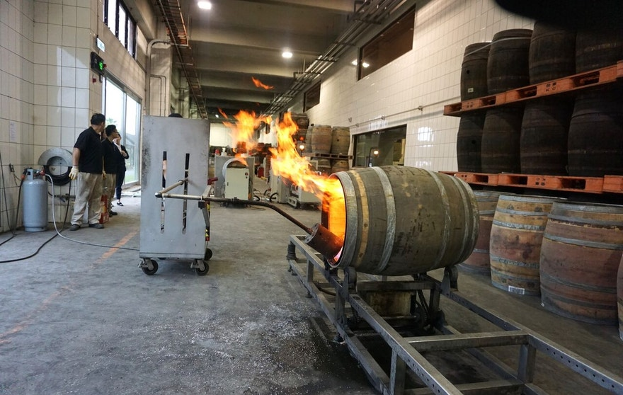 Charring the whisky barrels is said to boost the spirit's flavor as wood sugars are caramelized, the smoky flavors are absorbed by the liquid inside.