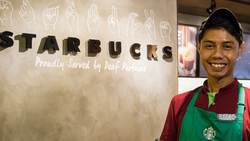 Muhammad Aizad Bin Ariffin, a Deaf store shift manager, has been with the company for three years.