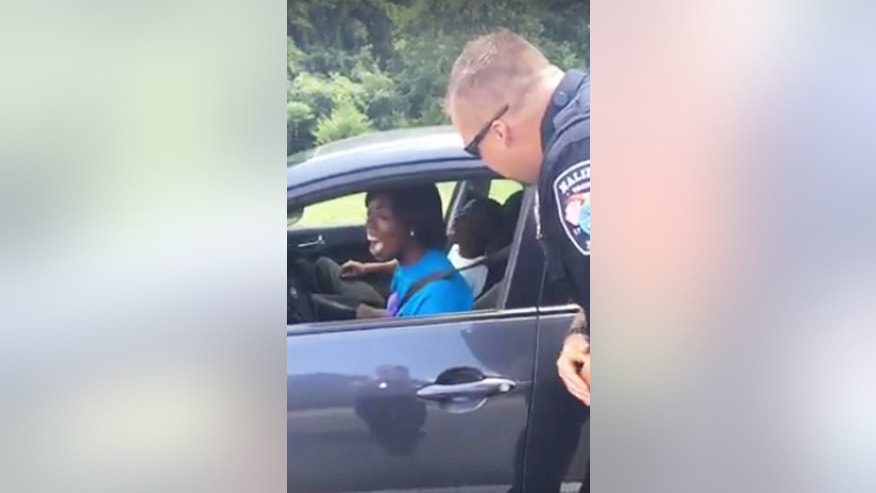 This cop isn't handing out tickets-- instead he's hot a sweet surprising for this unsuspecting driver.