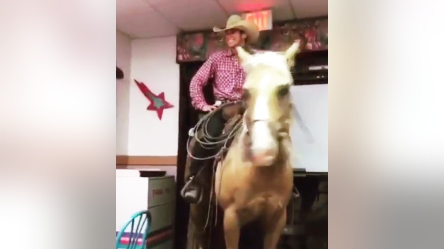 Professional cowboy Lathan Crump took his horse Hollywood for a ride...into a Taco Bell.