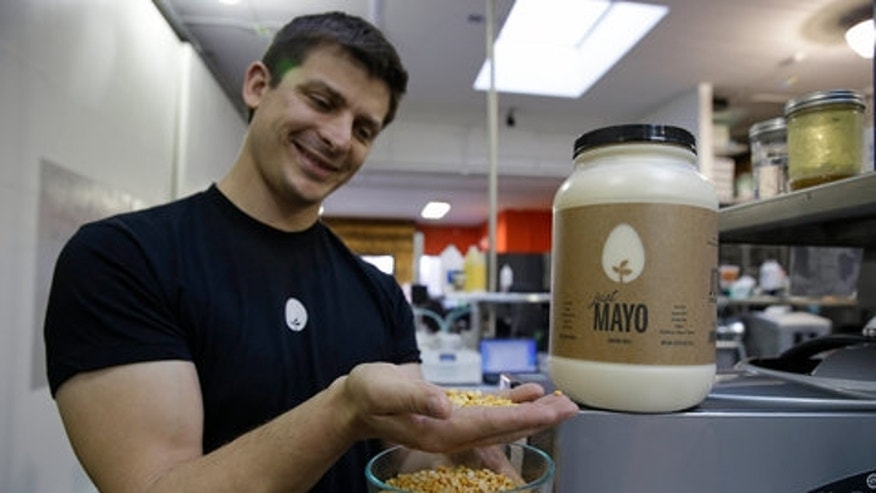 """Joshua Tetrick, founder and chief executive of Hampton Creek foods, with the company's """"Just Mayo"""" product."""