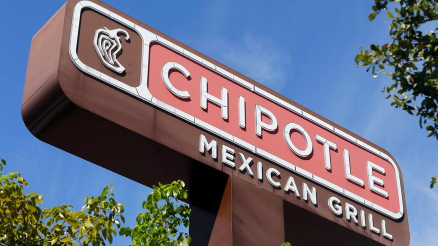 This Monday, Feb. 8, 2016, photo, shows the sign of a Chipotle restaurant in Hialeah, Fla. Chipotle is using free burrito offers to combat the eerie look of empty stores and convince people its safe to return. The offers come as Chipotle fights to recover from a series of food scares, with sales down 26 percent in February. (AP Photo/Alan Diaz)