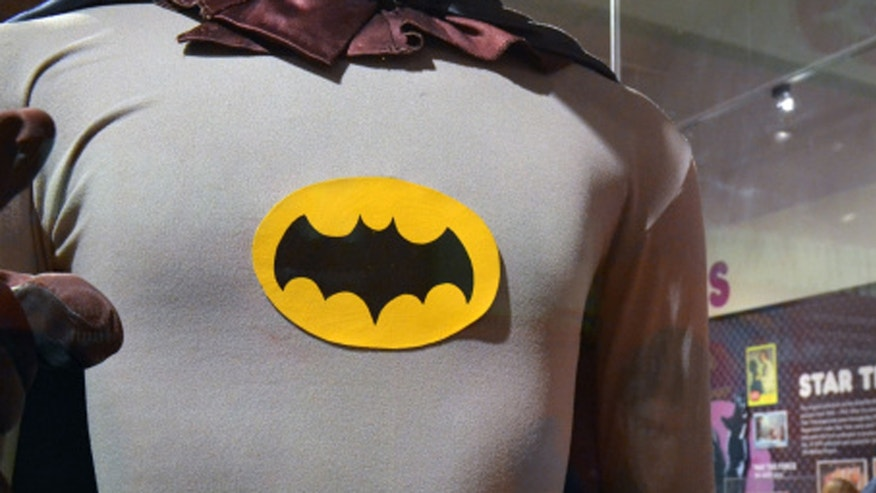 "A Batman costume worn by Adam West in the 1960s television show is on display next a Superman costume worn by Christopher Reeve in ""Superman IV"" at the Louisville Slugger Museum in Louisville, Ky., on Friday, May 29, 2015. The suits are part of a pop culture exhibit that runs through the summer. (AP Photo/Dylan Lovan)"