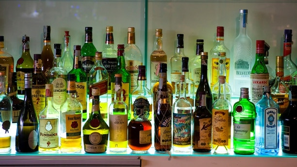 Pozzuoli, Italy  - December 26, 2012: Group of bottles at the back of a bar in Pozzuoli, Bay of Naples, Italy. Vodka, Scotch, malt whisky, Irish Whisky, Bourbon and other drinks.