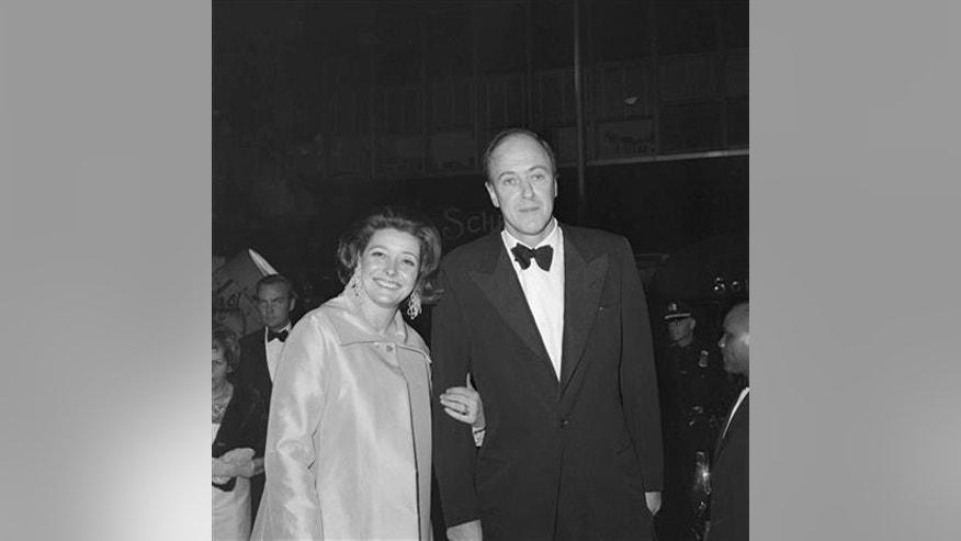 "In a Dec. 10,1968 file photo, writer Roald Dahl and his wife actress Patricia Neal arrive for the premiere of ""The Subject Was Roses,"" in New York. To mark the September 2016 centennial of Dahl's birth, tributes will range from a ""Traveling Trivia Tour"" to a re-release of the 1971 film ""Willy Wonka & the Chocolate Factory,"" starring Gene Wilder."