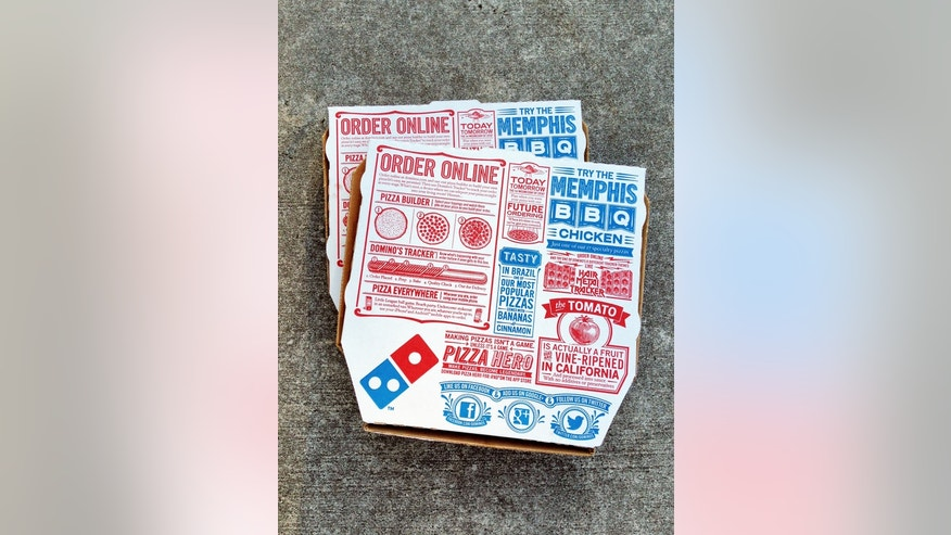 """West Palm Beach, USA - March 7, 2013: Two Domino's Pizza boxes. Domino's is one of the largest pizza delivery franchises in the USA. The packaging is covered with ads and pizza trivia, as well as ways to access Domino's through mobile phone apps and social media sites like Facebook and Twitter."""