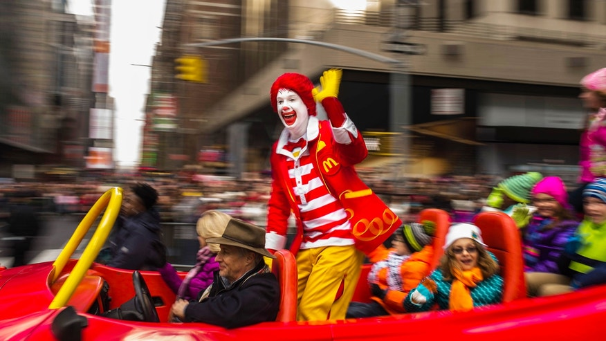 Ronald McDonald waves to the crowd during the Macy's Thanksgiving Day Parade, Thursday, Nov. 26, 2015,  in New York City.