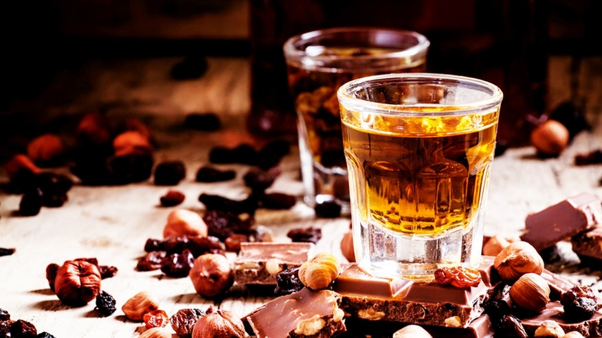 Milk chocolate with nuts and raisins with dark Jamaican rum, selective focus