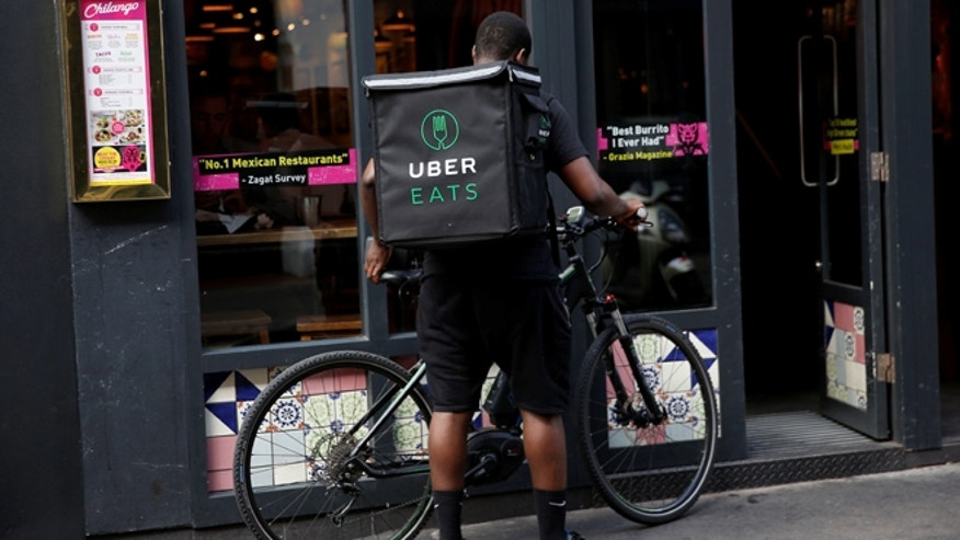 Lawsuit accuses Uber of keeping food delivery tips. (Reuters)