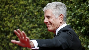 Chef Anthony Bourdain poses at the 2015 Creative Arts Emmy Awards in Los Angeles, California September 12, 2015. REUTERS/Danny Moloshok - RTSTGA