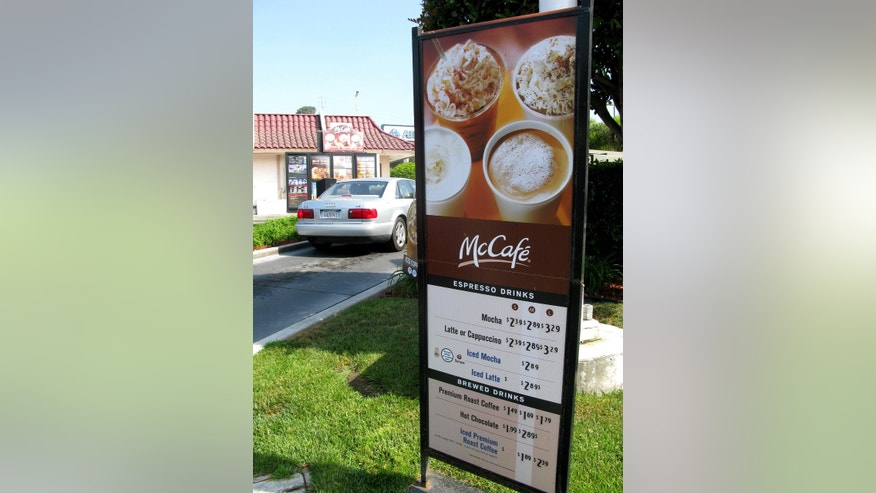 A drive-through menu displays McDonald's coffee offerings under the McCafe brand.