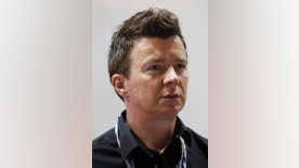 Singer Rick Astley looks on after the third practice session of the Singapore F1 Grand Prix at the Marina Bay street circuit in Singapore September 24, 2011. REUTERS/Edgar Su (SINGAPORE  - Tags: SPORT MOTOR RACING ENTERTAINMENT HEADSHOT)   - RTR2RS0H