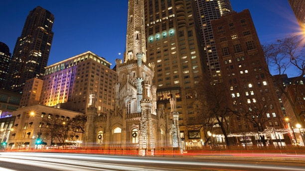 Image of Chicago Water Tower and Michigan Avenue during twilight blue hour.