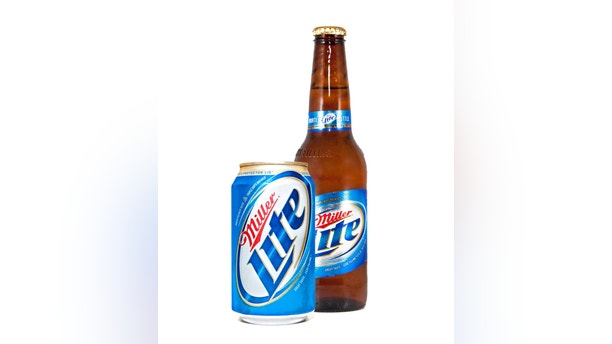 Nashville, Tennessee, USA - July 16th, 2011: A close up photo of a Miller Lite brown beer bottle behind a Miller Lite Beer can, with signature blue and gold label, shot against a white background.