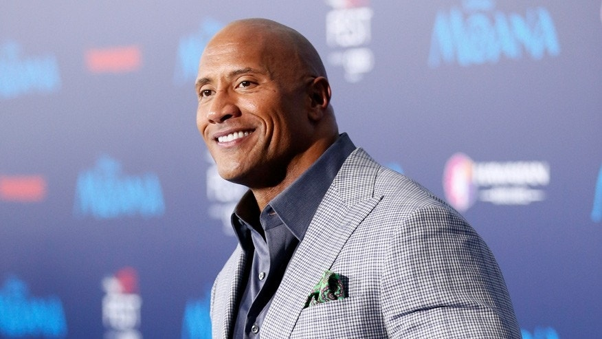 "Dwayne 'The Rock' Johnson poses at the premiere of Walt Disney Animation Studios' ""Moana"" in Hollywood, California, on November 14, 2016."