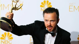 """Aaron Paul poses with his Outstanding Supporting Actor in a Drama Series for AMC's """"Breaking Bad"""" at the 66th Primetime Emmy Awards in Los Angeles, California August 25, 2014.  REUTERS/Mike Blake (UNITED STATES -Tags: ENTERTAINMENT)(EMMYS-BACKSTAGE) - RTR43QY4"""