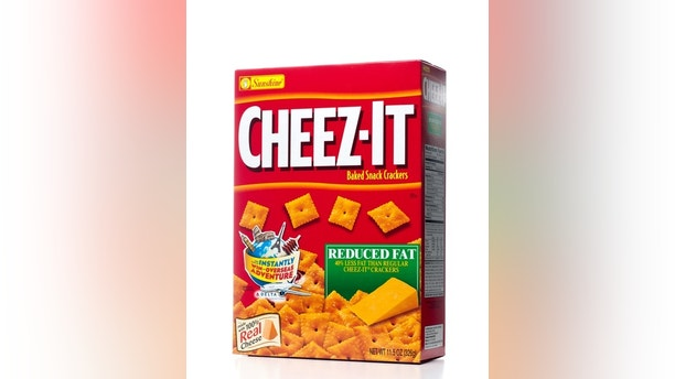 Miami, USA - December 21, 2011: CHEEZ-IT Baked Snack Crackers Reduced Fat 11.5 OZ box. CHEEZ-IT baked Snack Crackers is manufactured by the Kellogg Company through its division Sunshine Biscuits.