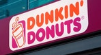 """Berlin, Germany - May 17, 2012:  Dunkin Donuts logo sign at the entrance to one of their stores. Dunkin Donuts is an international doughnut and coffee retailer founded in 1950 that has more than 10,000 locations in 32 countries worldwide."""