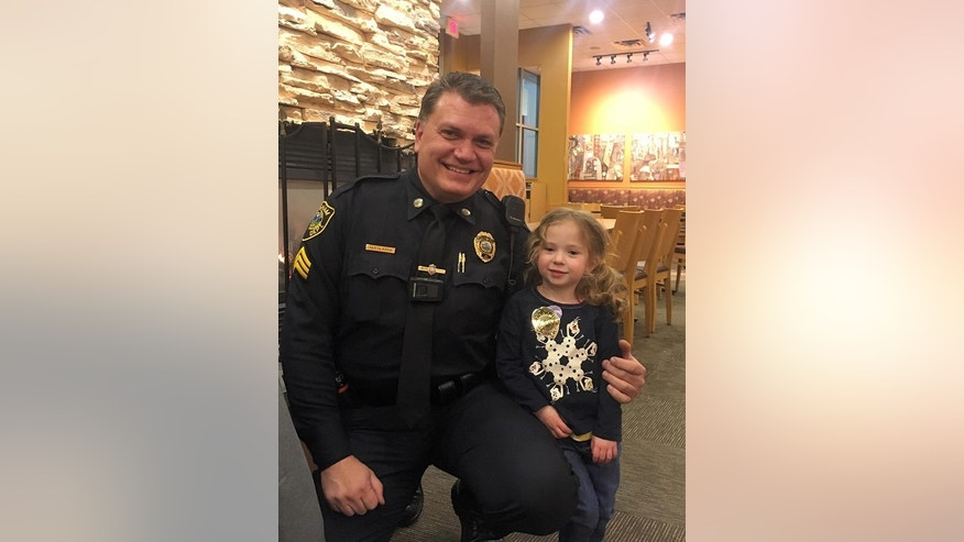 4-year-old Lillian saw Hingham Sergeant Steve Dearth eating alone and asked to join him.