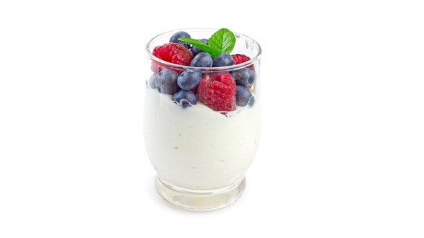 yogurt, berries and mint in glass isolated on white with clipping path