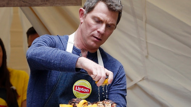 "Chef Bobby Flay turned ""head counselor"" demonstrates how to make delicious summer dishes using Lipton Iced Tea at Lipton Summer Camp on Thursday, June 8, 2017, in New York. The event gave people a chance to re-live their favorite summertime memories right in Herald Square. For more information on the recipes and to learn how you could enter for a once-in-a-lifetime Food Network Star experience to dine with Bobby Flay visit www.liptonmeal.com. (Jason DeCrow/AP Images for Lipton)"