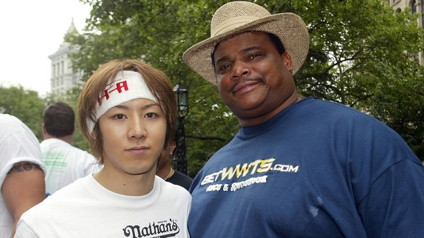 Takeru Kobayashi (L), current world hot dog eating champion from Japan,