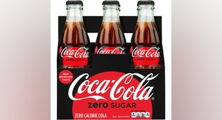 This photo provided by Coca-Cola shows a six-pack of bottled Coca-Cola Zero Sugar. Coke Zero is getting a makeover as Coke Zero Sugar in the United States. The new cans and bottles, which will incorporate more red like regular Coke, will start hitting shelves in August 2017. The company says people didn't always understand that Coke Zero's name means it has no calories. The push comes as Diet Coke's sales continue to decline. (Rodger Macuch/Courtesy of Coca-Cola via AP)