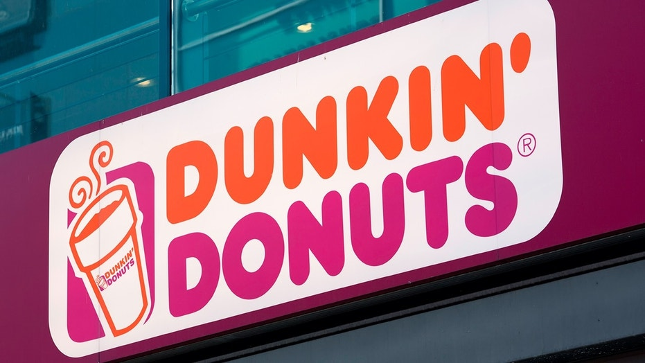 An employee at a Dunkin' Donuts in Brooklyn is accused of refusing service to two NYPD officers
