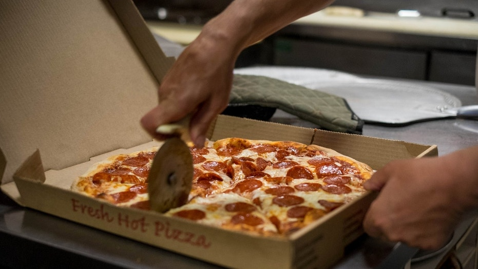 A pizzeria is under fire for alleged anti-cop slurs.