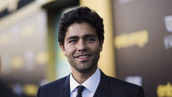 "June 3, 2015. Adrian Grenier poses at the movie premiere of ""Entourage"" in Los Angeles, California."