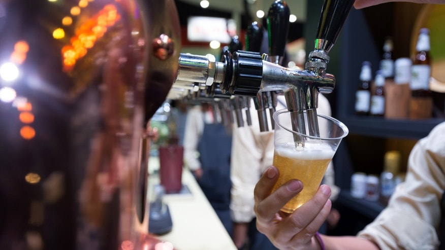 A man is claiming that he was hospitalized after drinking a draft beer.