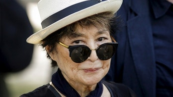 Artist Yoko Ono, widow of John Lennon, attends the unveiling of a tapestry honoring Lennon at Ellis Island in New York July 29, 2015. REUTERS/Eduardo Munoz - GF20000008275