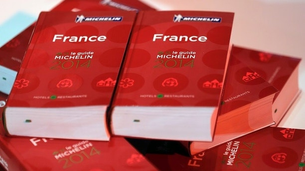 Copies of the new 2014 annual Michelin restaurant guide are presented during the announcement of the newly-promoted chef in Paris, February 24, 2014.    REUTERS/Philippe Wojazer (FRANCE - Tags: FOOD BUSINESS TRAVEL) - PM1EA2O113S01