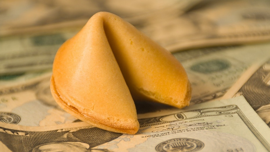 fortune cookie with money istock