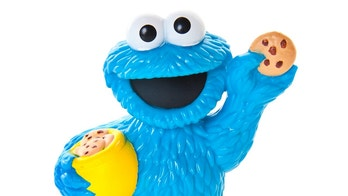 "Albuquerque, USA - October 30, 2012: Cookie Monster is a popular character on the children's television show Sesame Street. This Muppet is best known for his huge appetite and his famous eating phrases: ""Me want cookie!"", ""Me eat cookie!"" The Sesame Street program is known for its educational content, and creative use of Jim Henson's Muppets to communicate wide variety of messages to young kids."