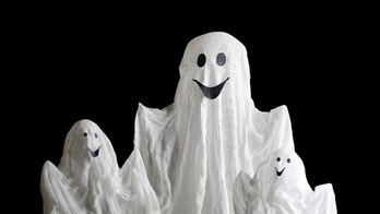 Halloween ghosts, on home interior background
