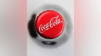 FILE - This April 25, 2011, file photo shows a cap on a bottle of Coca-Cola in Philadelphia. The Coca-Cola Co. reports earnings Wednesday, Oct. 25, 2017. (AP Photo/Matt Rourke, File)
