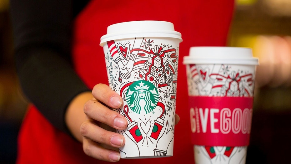 starbucks holiday cup causes social media buzz over mystery hands