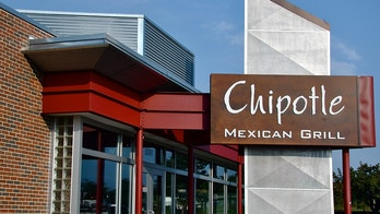 """Falls Church, VA, USA - August 19, 2011:  Chipotle Mexican Grill sign.  Chipotle Mexican Grill, Inc. (NYSE: CMG) is a popular American chain of over 1000 restaurants specializing in burritos and tacos.  The name \""""Chipotle\"""" comes from the Mexican word for a smoked, dried jalapeAo chili pepper."""
