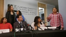 "Gladys Fuentes, right, one of five female kitchen workers in Boston speaks about her experiences while detailing a sexual harassment lawsuit the women are filing against McCormick & Schmick's, a national restaurant chain featuring seafood and steaks Tuesday, Dec. 12, 2017, in Boston. The Lawyers' Committee for Civil Rights and Economic Justice, a Boston-based nonprofit representing the women, says the lawsuit alleges a workplace filled with ""lewd behavior, sexually inappropriate comments and unwanted touching."" Also pictured are plaintiff Marta Romeno (left to right), attorney and interpreter Ivan Espinoza-Madrigal, plaintiff Fabiana Santos, attorney's Rachel Smith (back row left to right) and Sophia Hall. (AP Photo/Stephan Savoia)"