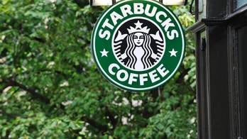 Edinburgh, Scotland - July 19, 2011:  A Starbucks Coffee sign outside a Starbucks Coffee outlet on Edinburgh's Royal Mile. Starbucks Corporation is an international coffee and coffeehouse chain based in Seattle, Washington.