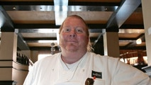 "Celebrity chef Mario Batali poses in his latest restaurant, Del Posto, in New York April 11, 2006. Known to fans as ""Super Mario,"" his most recent venture, Del Posto, has attracted as much attention for the price of valet parking - $29, as for the quality of the food. Photo taken April 11, 2006.   To match feature Life-Food.   REUTERS/Brendan McDermid - GM1DSLTNBZAA"