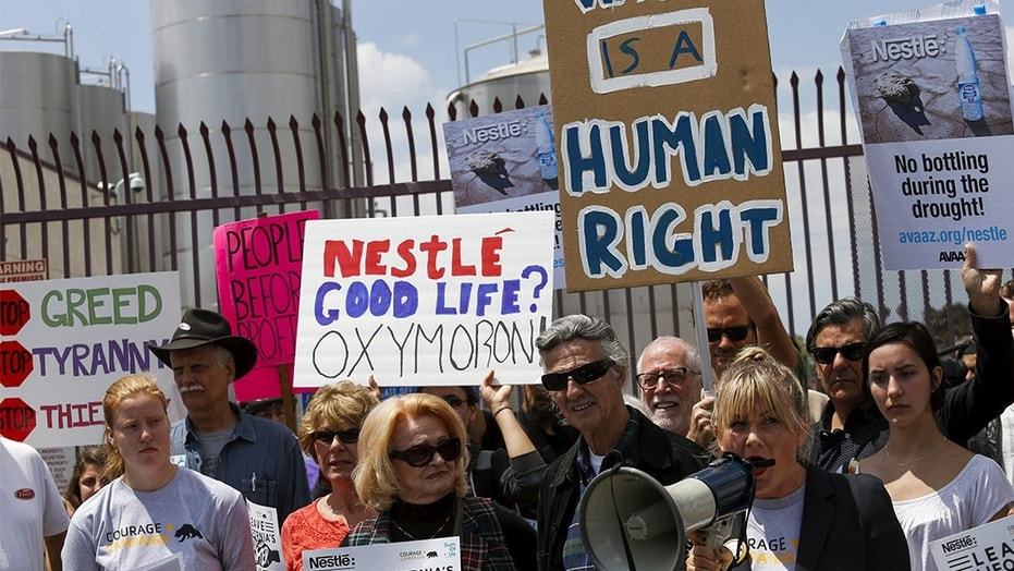 Protestors gather outside a Nestle Arrowhead water bottling plant in Los Angeles.